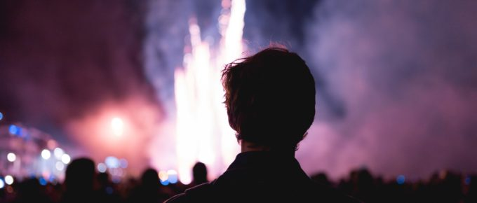 man looking at fireworks, thinking abiout the year of new content.